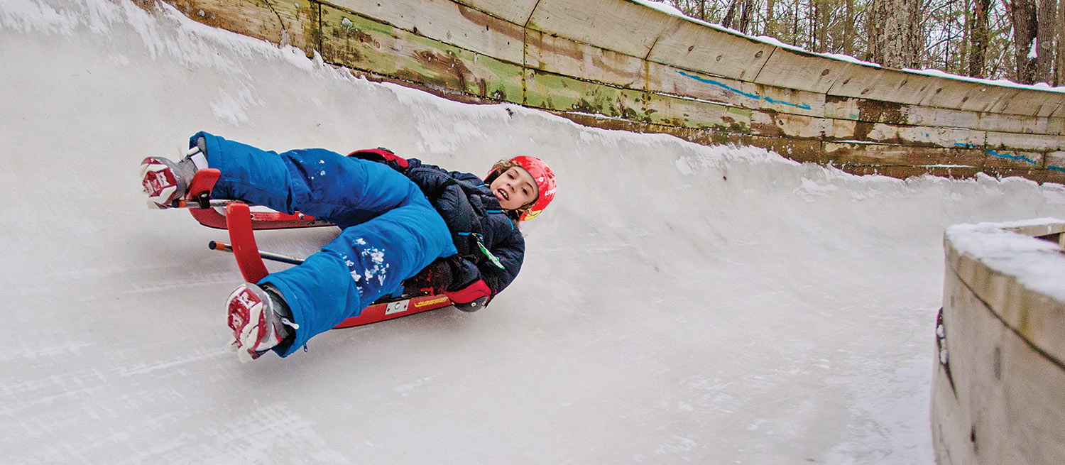 boy on winter luge track