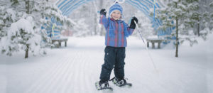 small child with snowshoes