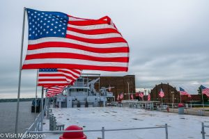 American Flag flying on deck of USS LST