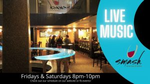 People sitting around a table in a dimly lit bar with caption Live Music Friday and Saturday