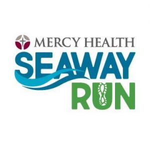 square graphic. white background. text in shades of teal, blue and green reads mercy health seaway run. gray and maroon logo preceeds text.